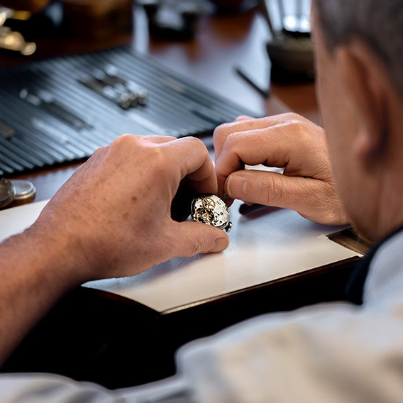 Watchmaker working on an vintage watch.