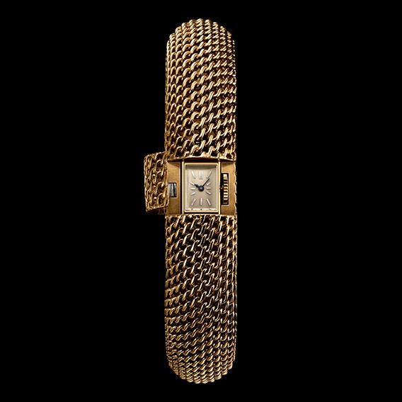 1950. Milanese mesh watch with hidden dial.