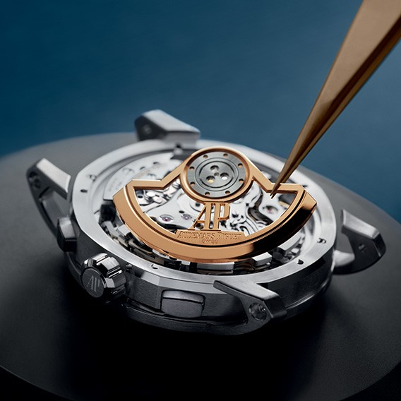 Adding the oscillating weight to the Code 11.59 by Audemars Piguet Selfwinding Chronograph. Calibre 4401.